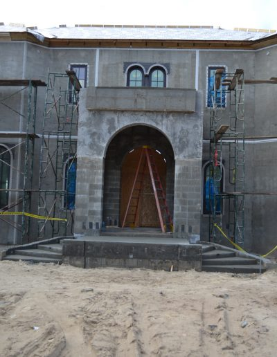 the arched entrance to a building, crated with concrete blocks