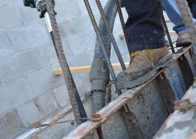 a worker works on a concrete block