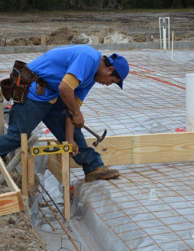 a worker swings a hammer