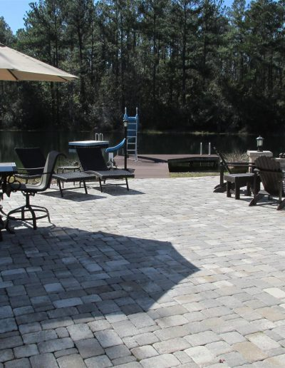 outdoor patio crated with pavers; large enough for patio furniture and a fire pit