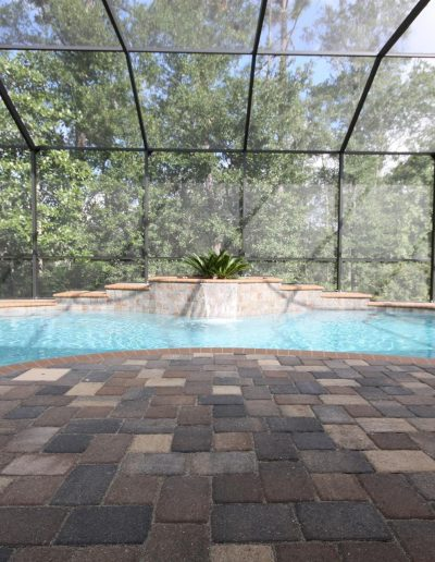 pool deck and raised waterfall feature