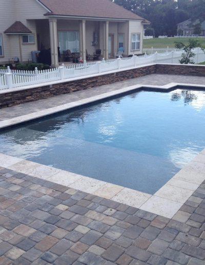 pool deck around a rectangular pool