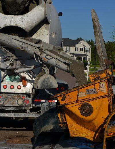a concrete truck pours concrete