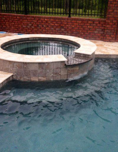 hot tub and pool deck created by Walker Footings
