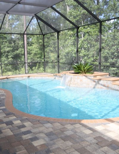 pool with sheer descent water feature and surrounding deck built by Walker Footings
