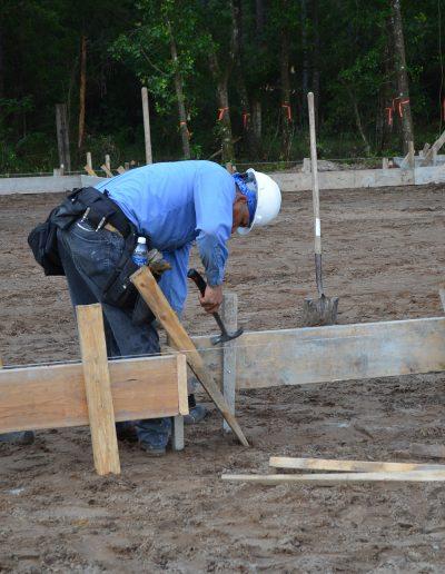 worker swinging hammer