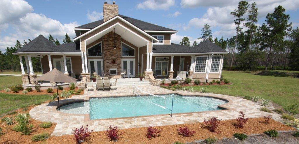 pool surrounded by patio built by Walker Footings