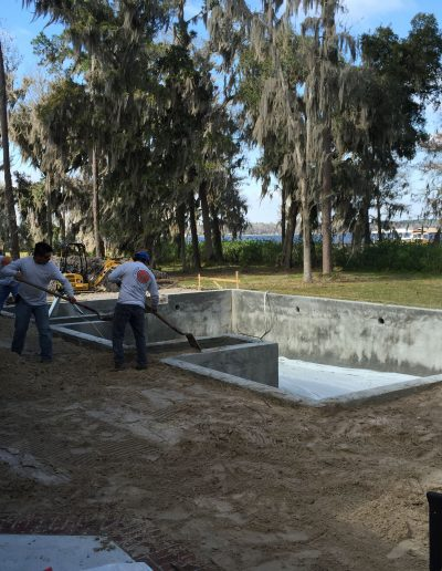 two men working on a concrete foundation